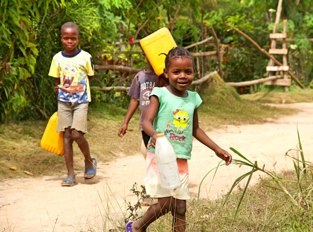 children gathering freshwater in haiti