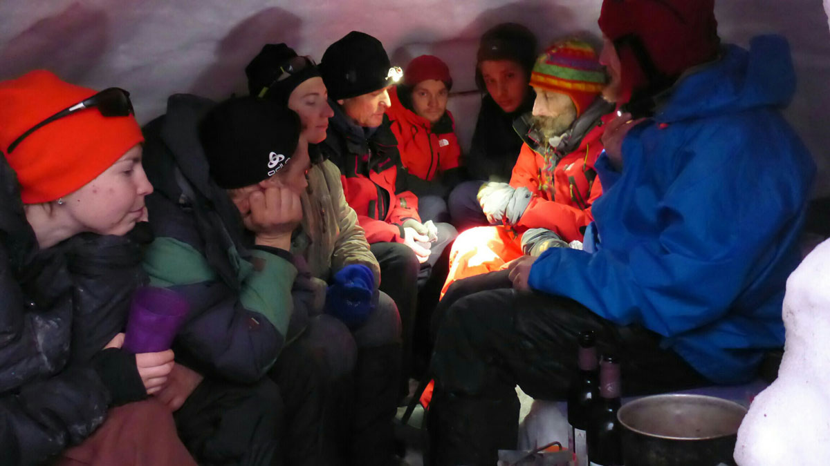 expedition participants in the snow kitchen after completing the cave exploration