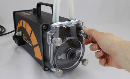 position the solinst peristaltic pump head cover and screw it firmly in place by hand